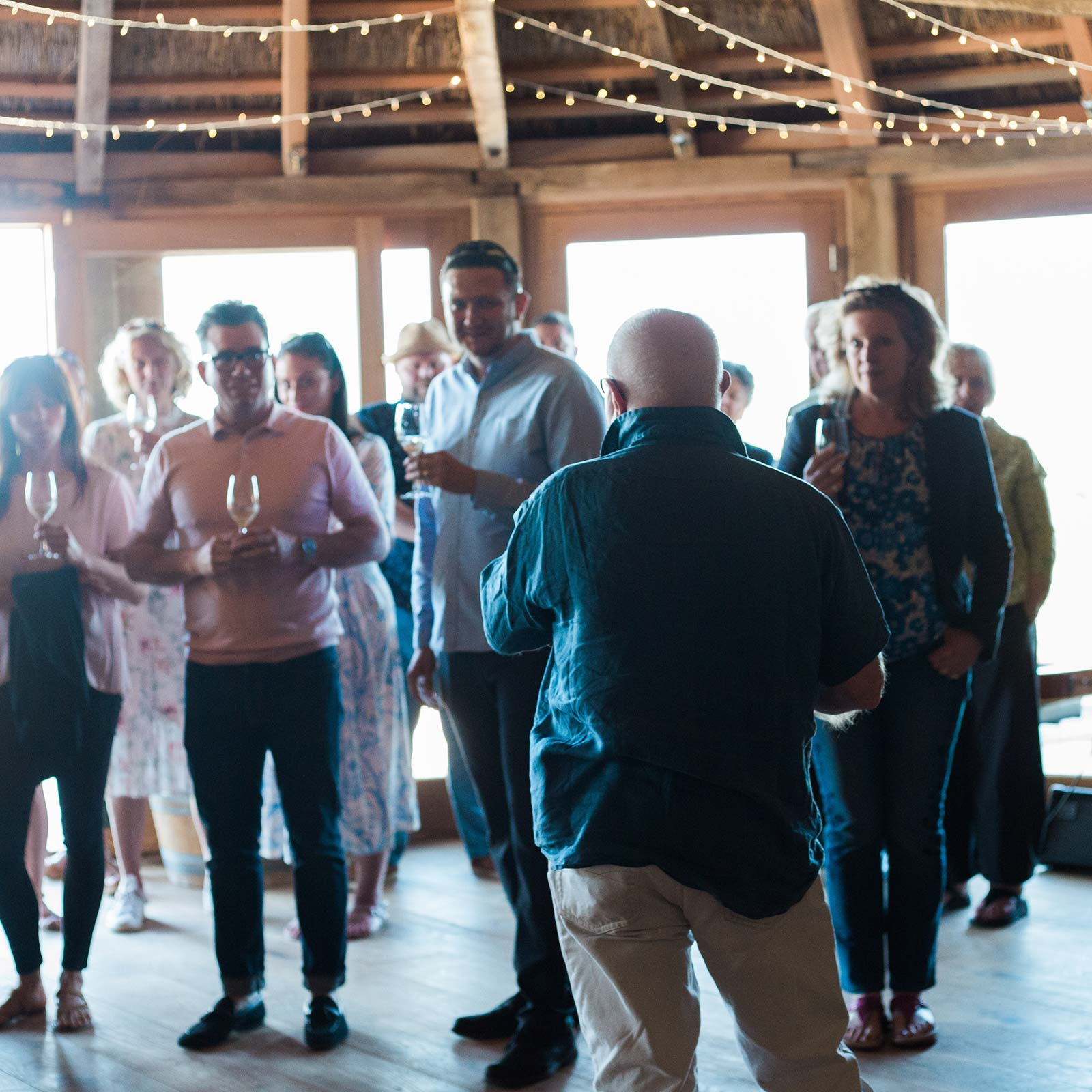Guests enjoying drinks inside the round house at Brickhouse Vineyard's corporate event party.
