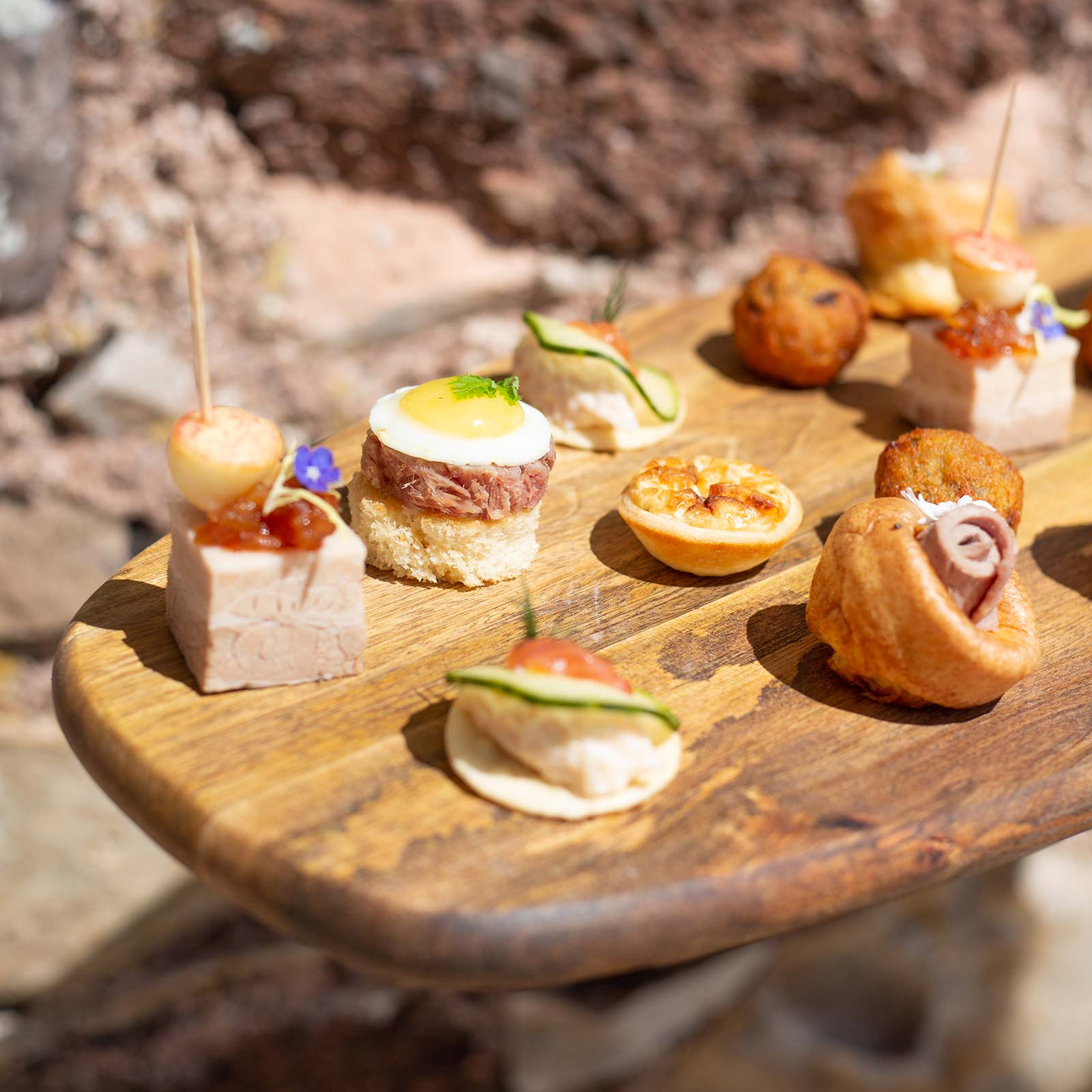 Canapés served on rustic wooden board for intimate wedding at Brickhouse Vineyard.