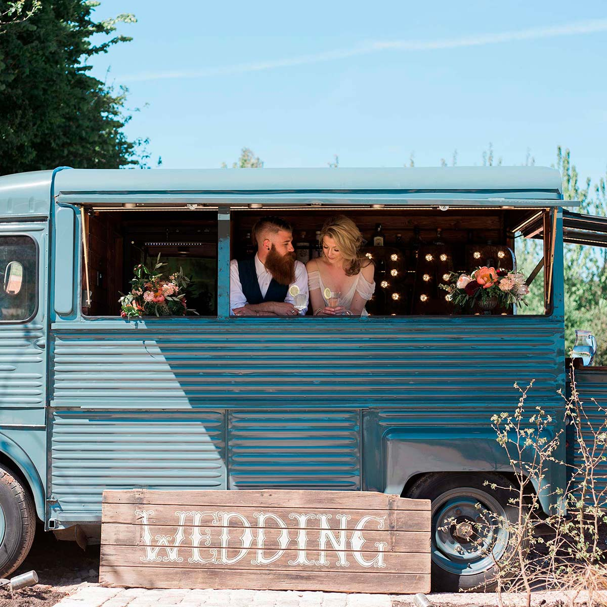 Elope packages - bride and groom in an old Citroen van mobile bar at Brickhouse Vineyard