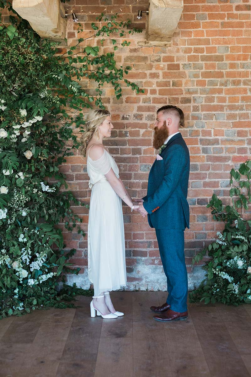 Elopement weddings - bride and groom exchanging vows in the round house