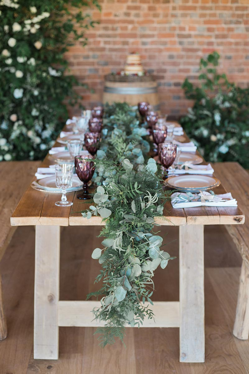 Rustic table setting in the round house at Brickhouse Vineyard - an affordable wedding venue