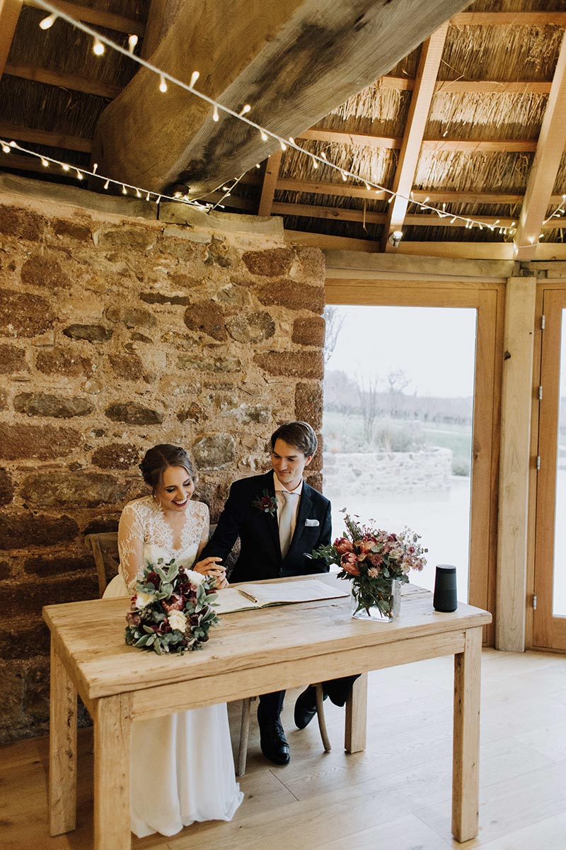 Small wedding packages - signing the register in the round house