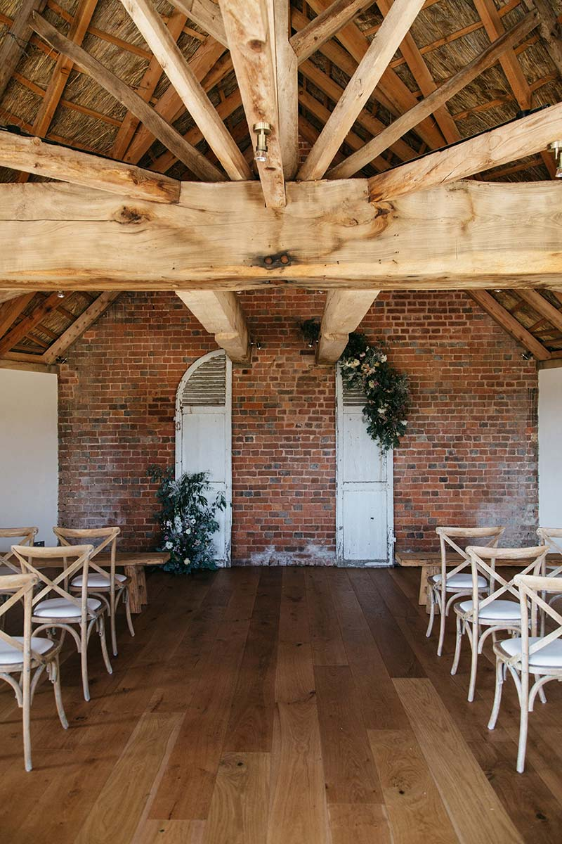 Same sex wedding venue - cross back chairs arranged in the round house