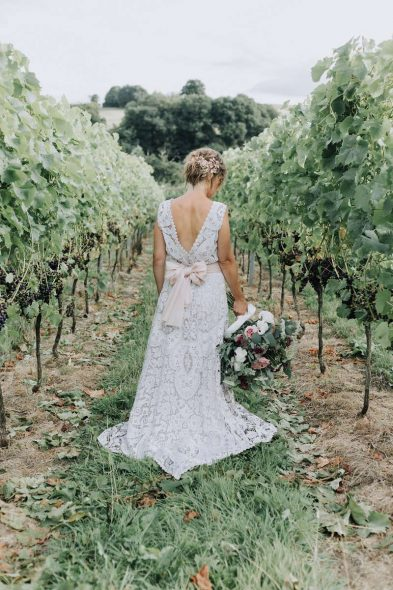 Bride between Grapevines