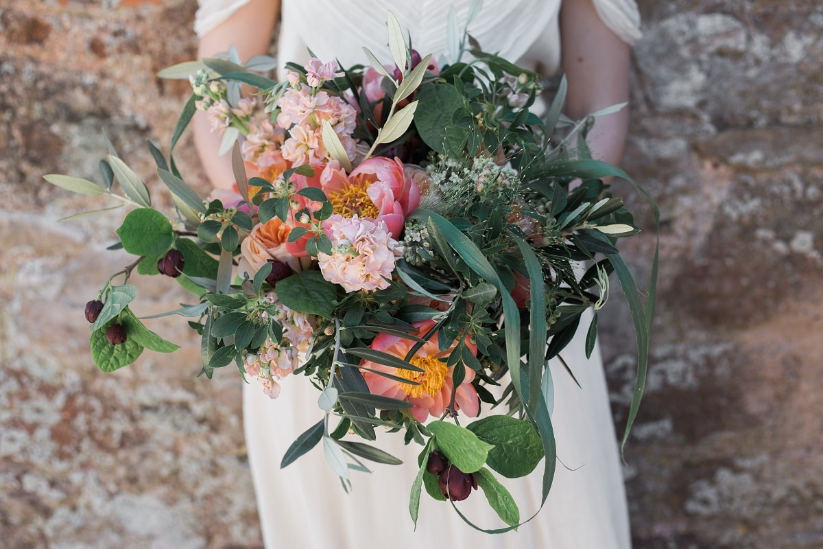 Beautiful wedding bouquet with peonies
