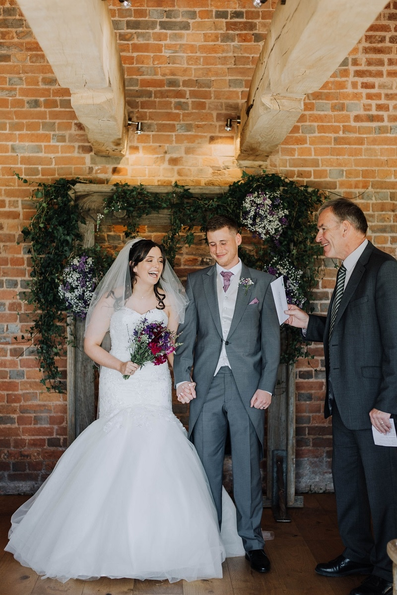 Bride and groom just married inside Devon barn wedding venue