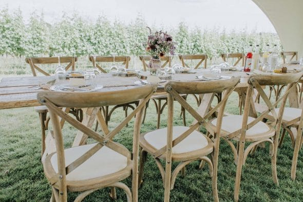Rustic wedding table setting outside at Brickhouse Vineyard in Devon