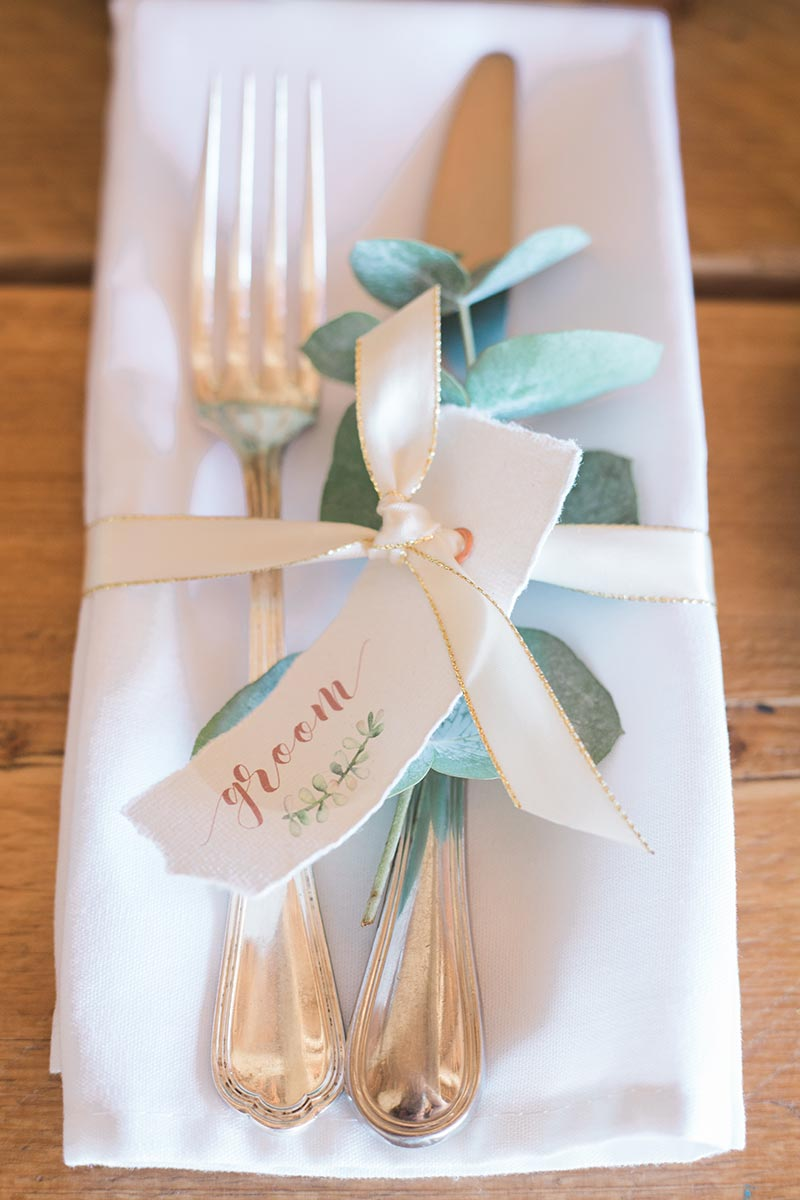 A wedding name place card on the table for an intimate wedding