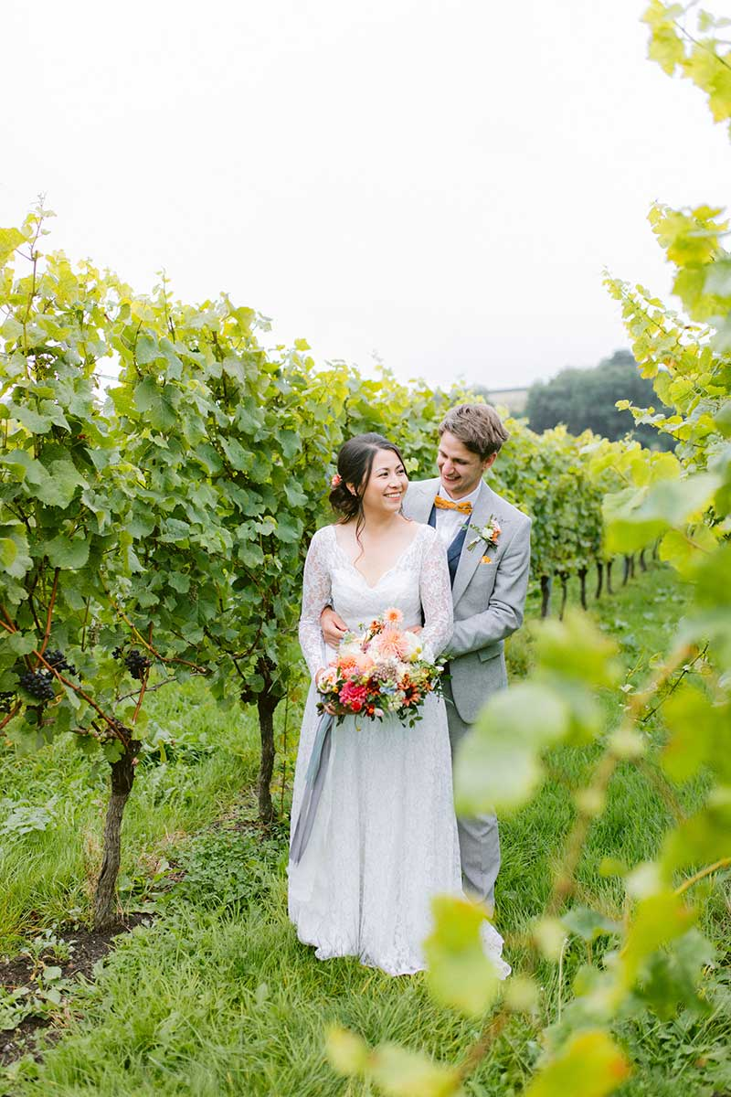 Couple in the vineyard for wedding photos
